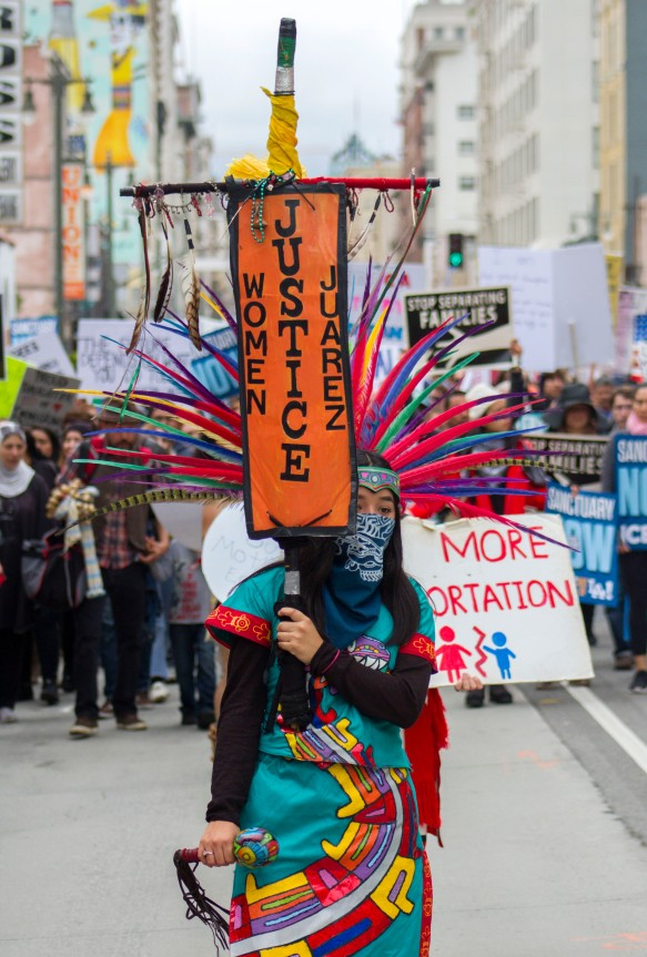 """A woman in a native Mexican garb protests during the """"Free the People"""" march in downtown Los Angeles on February 18th, 2017."""
