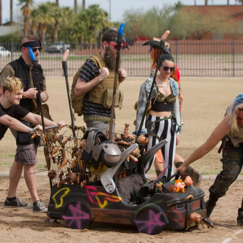 A team in the annual Phoenix Idiotarod pushes their shopping cart onto a volleyball court to compete against other teams at Verde Park in downtown Phoenix, Arizona on February 11th, 2017.