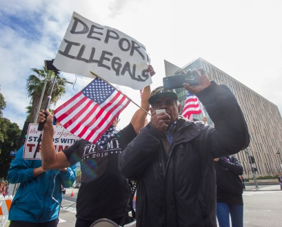 """Raymond Herrera calls for the deportation of illegal immigrants during the """"Free The People"""" pro-immigrant march in downtown Los Angeles on February 18th, 2017."""