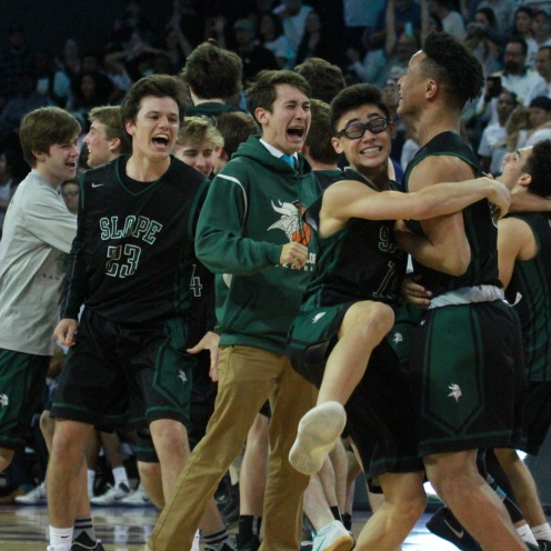 Players from the Sunnyslope High School basketball team celebrate after winning the 5A Conference boys basketball championship by one point in double overtime on February 27th, 2017 in Phoenix, Arizona.
