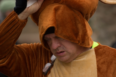 "William Robles removes the mask of his bull costume during a Phoenix inaguration day protest on January 20th, 2017 at the Arizona State Capitol. Robles said the costume was inspired by the ""No bull"" slogan of local car company Earnhardt Auto Sales."