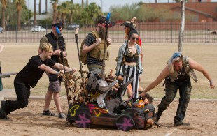 A team in the annual Phoenix Idiotarod race pushes their shopping cart onto a volleyball court to compete against other teams at Verde Park in downtown Phoenix, Arizona on February 11th, 2017.