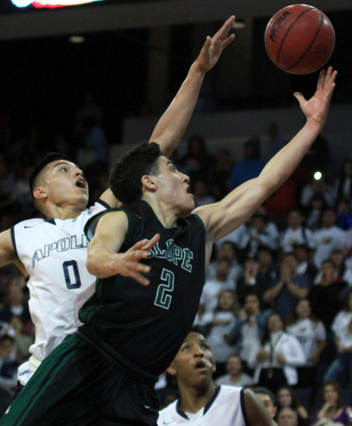 Sunnyslope High School player Allan Abayev shoots a layup while Jeff Perez of Apollo High School attempts to block during the 5A Conference Boy's Basketball Championship on February 27th, 2017 in Phoenix, Arizona.