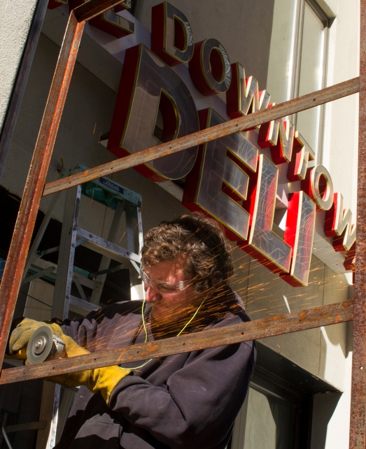 Welder Krisjan Cotowich works on a new patio in front of what was formerly The Downtown Deli on Central Avenue in downtown Phoenix, Arizona on January 31st, 2017.