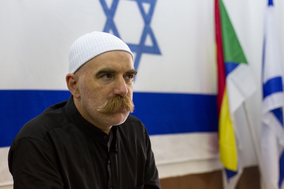 A Druze official sits in his office in Beit Jann, Israel on August 2nd, 2019